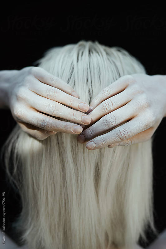 Blond hair and white hands close up by Jovana Rikalo for Stocksy United