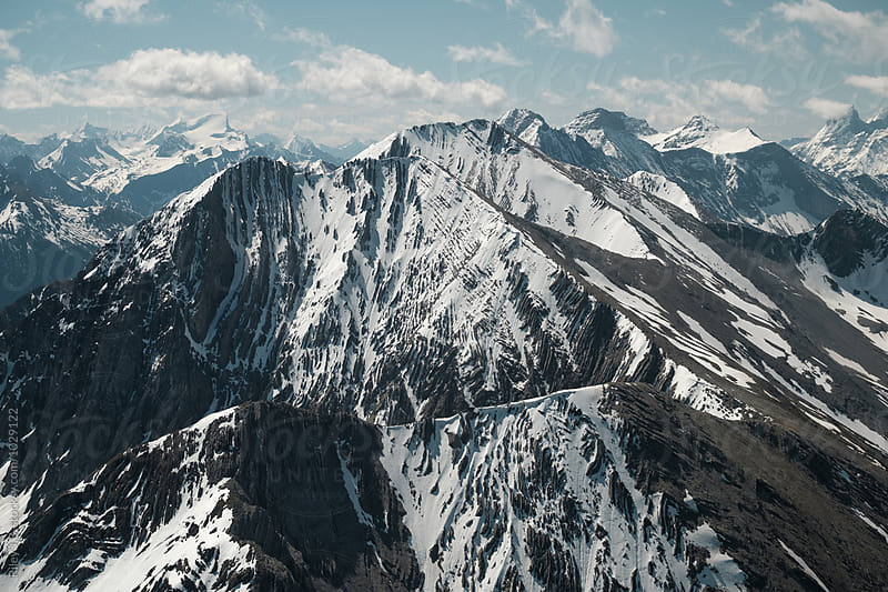 Rocky Mountain range covered in snow by Riley J.B. for Stocksy United