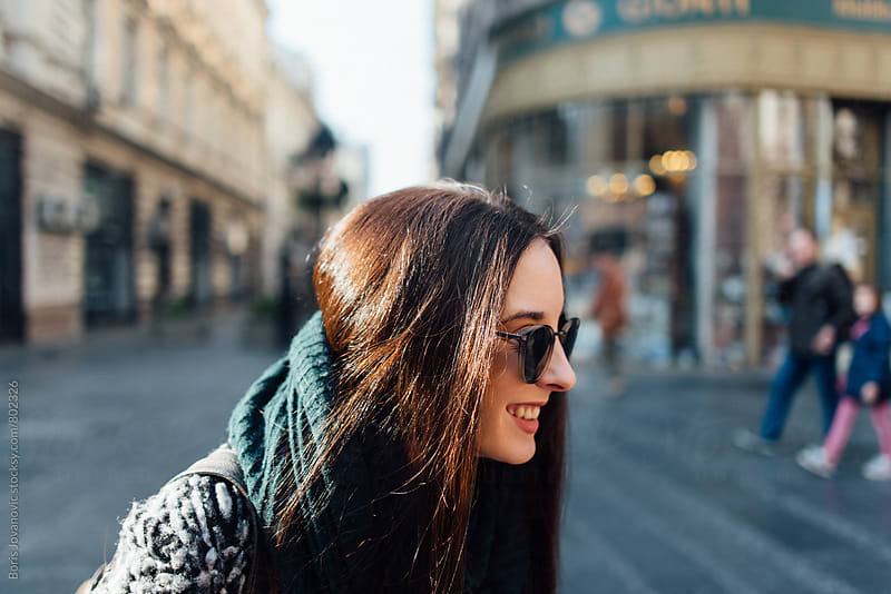 Portrait of smiling woman with sunglasses by Boris Jovanovic for Stocksy United
