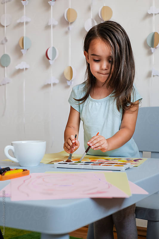 Little Girl Playing With Watercolors by Mosuno for Stocksy United