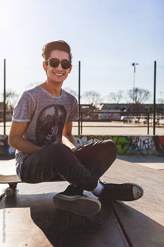 Cheerful Young Skateboarder Portrait at the Skatepark by Giorgio Magini for Stocksy United
