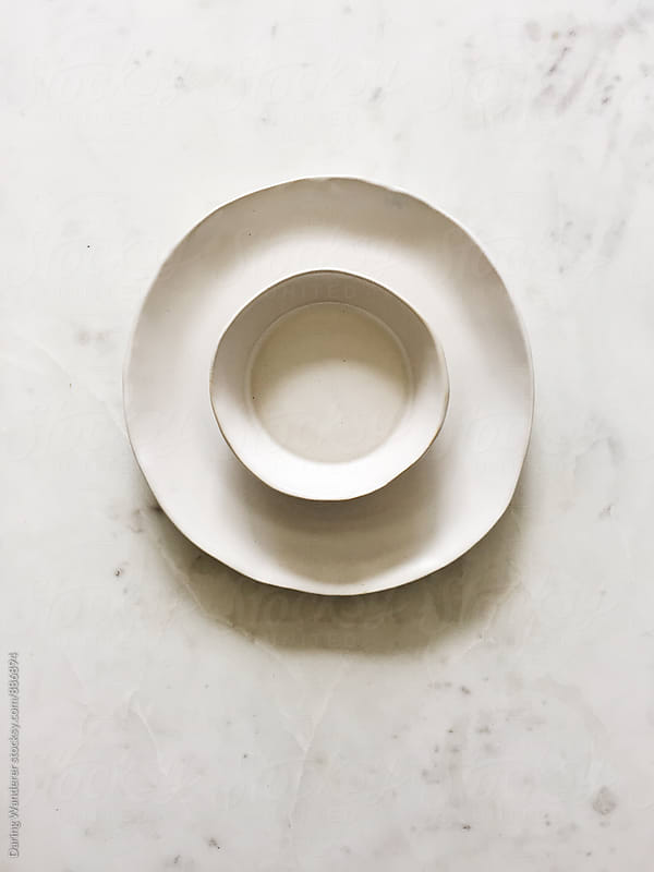 Handmade asymmetrical pottery on marble table top by Daring Wanderer for Stocksy United