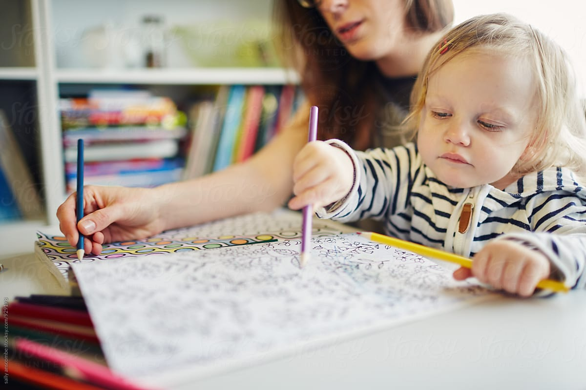 Young Woman And Child Colouring In A Pattern | Stocksy United