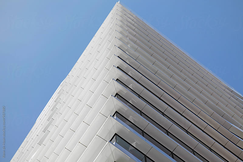 modern building against blue sky by Rene de Haan for Stocksy United