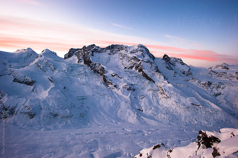 Panorama of Breithorn at sunrise by Peter Wey for Stocksy United