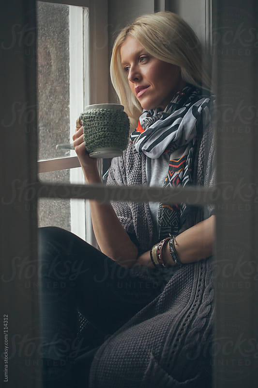 Woman Drinking Tea by the Window by Lumina for Stocksy United