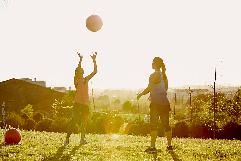 Women Exercising With Medicine Ball In Park by ALTO IMAGES for Stocksy United