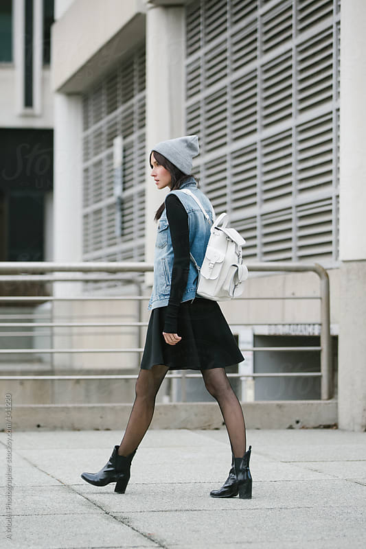 A trendy student walking away from the camera by Ania Boniecka for Stocksy United