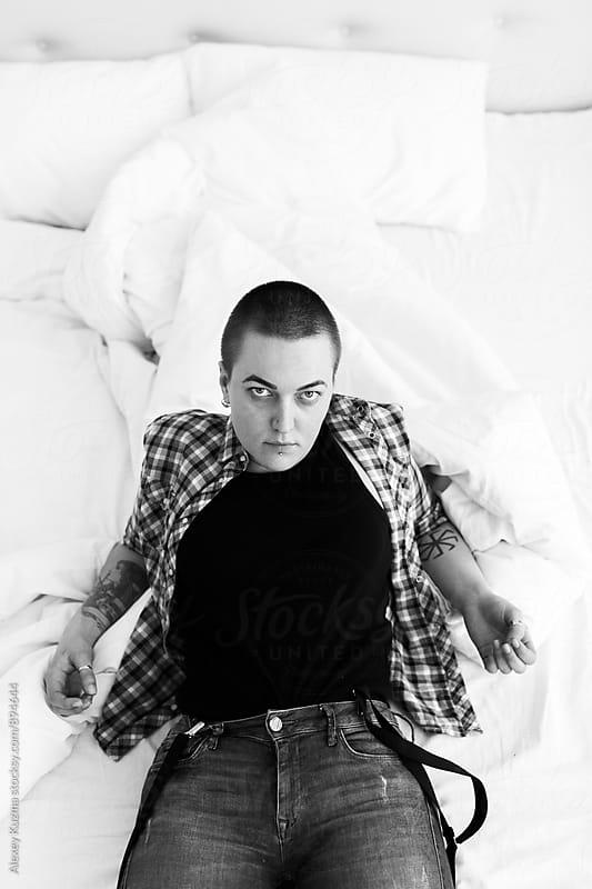 portrait of lesbian woman by Alexey Kuzma for Stocksy United