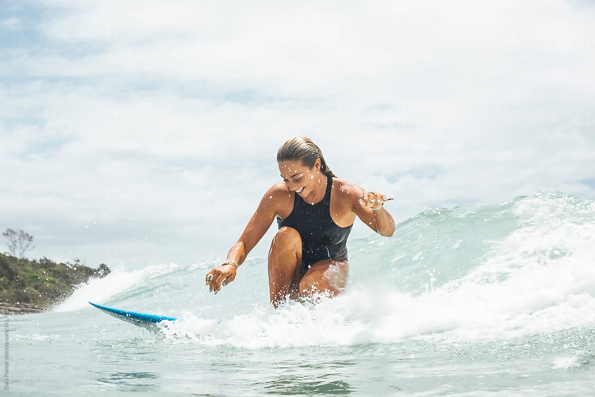 Stock Photo A Young Happy Woman Surfing