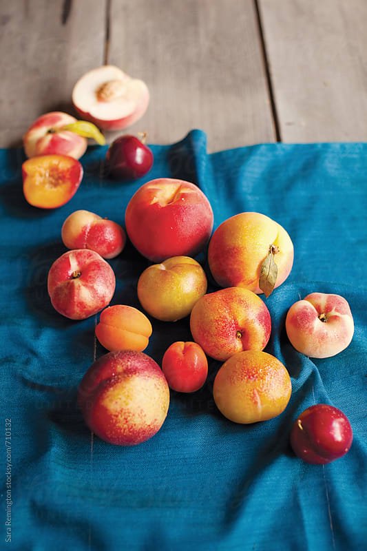 Stone Fruit on Blue Linen by Sara Remington for Stocksy United
