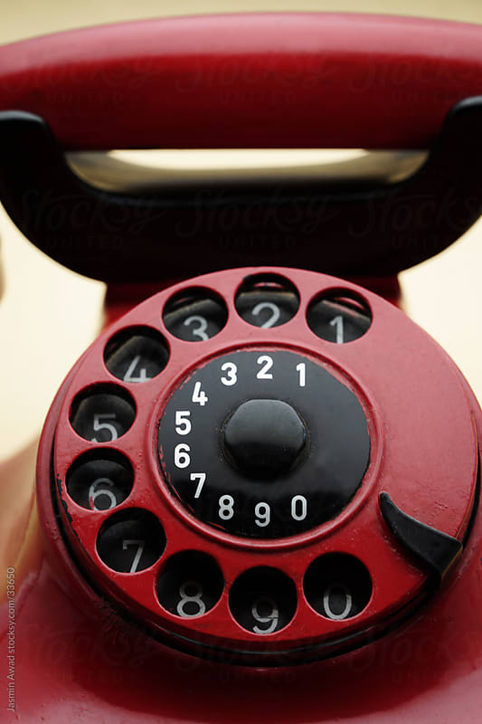 Retro vintage phone with marks and scratches  by Jasmin Awad for Stocksy United