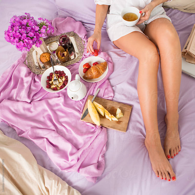 Woman Having Breakfast in Bed by Lumina for Stocksy United