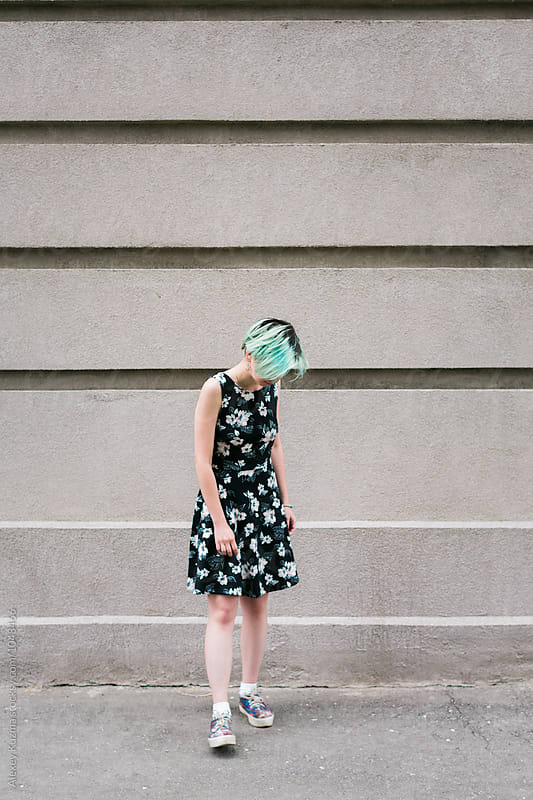 young woman with green hair by Alexey Kuzma for Stocksy United