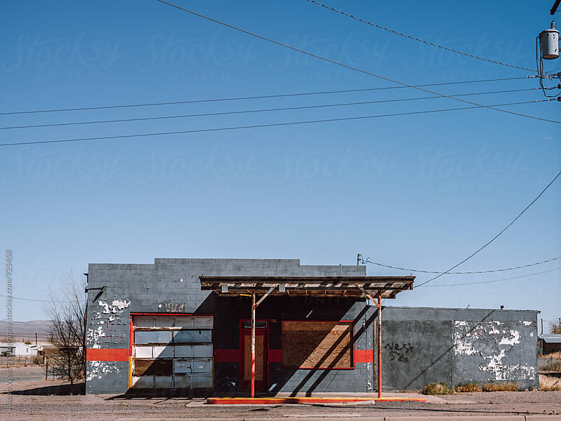 An abandoned service station in the desert by Joseph West Photography for Stocksy United