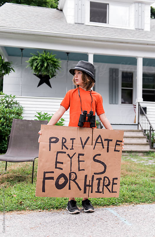 Child holds handmade Private Eyes for Hire sign by Cara Slifka for Stocksy United