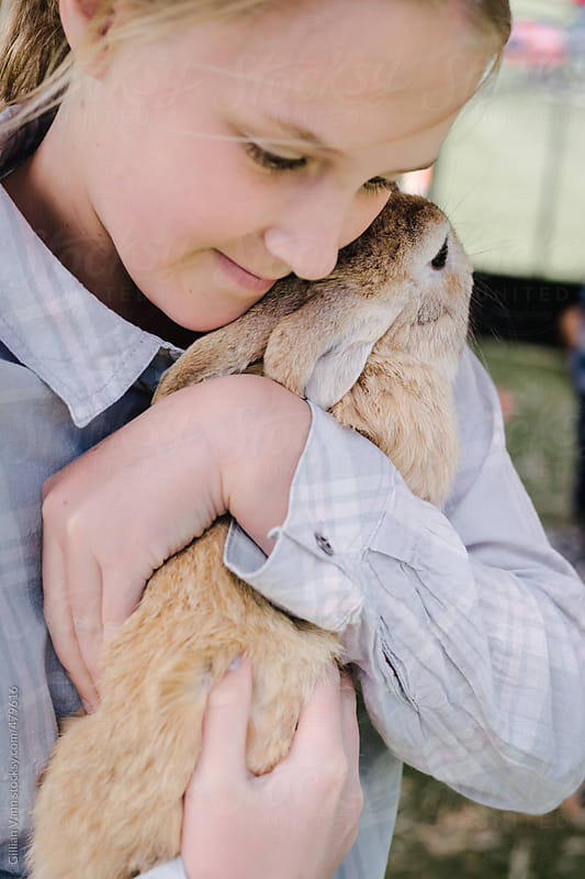 tween girl holding a pet bunny by Gillian Vann for Stocksy United