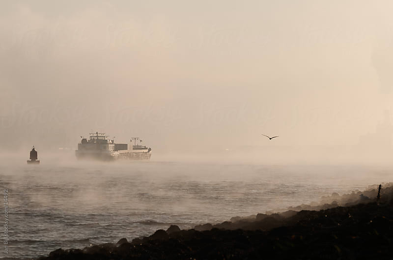 ships in the fog over the river Maas, the netherlands by Jan Bijl for Stocksy United