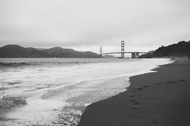 Beach with the Golden Gate Bridge in the background by michela ravasio for Stocksy United