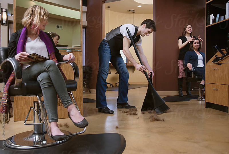 Man cleaning floor in hair salon by Andersen Ross Photography for Stocksy United