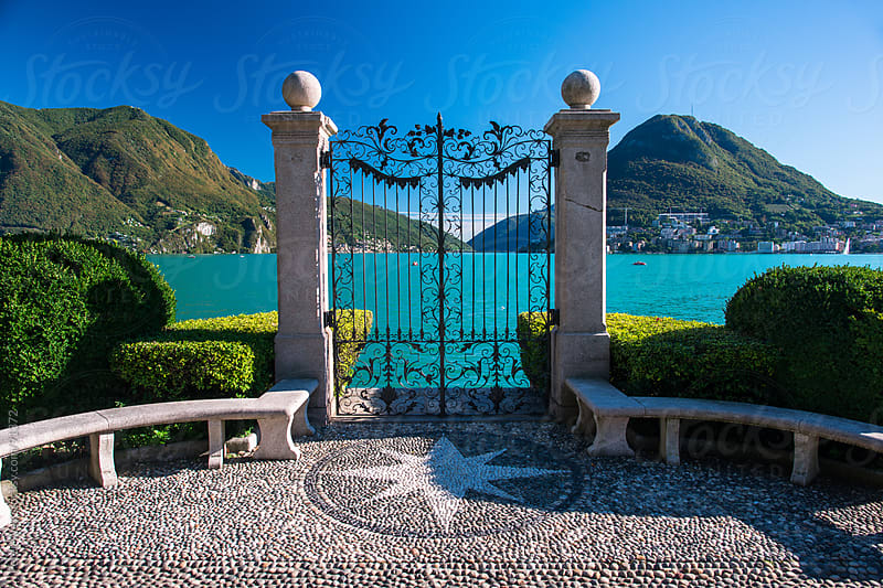 Gate to lake Lugano  by Peter Wey for Stocksy United