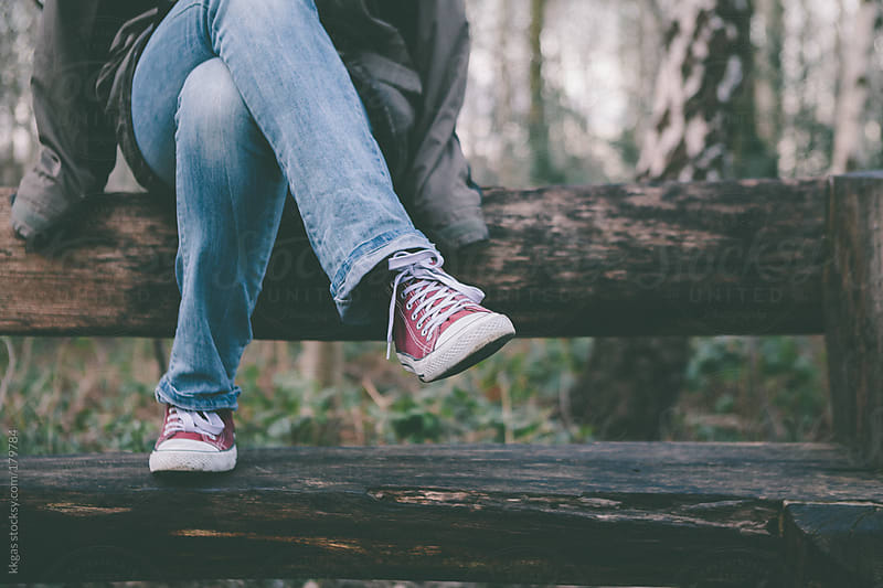 Woman's legs wearing sneakers and jeans. by kkgas for Stocksy United