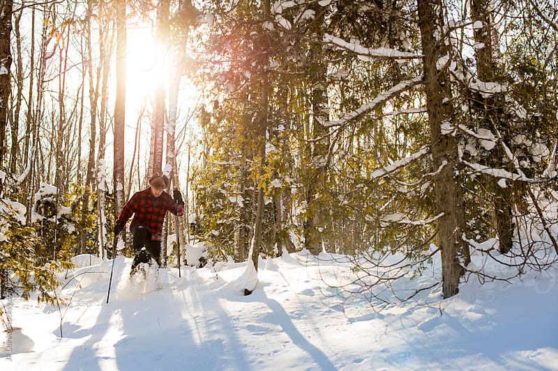 Man With Snowshoes in Cold Winter Forest With Snow by JP Danko for Stocksy United