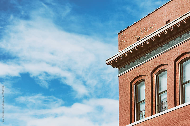 Old Brick Building With Copyspace Over Blue Sky by Sean Locke for Stocksy United