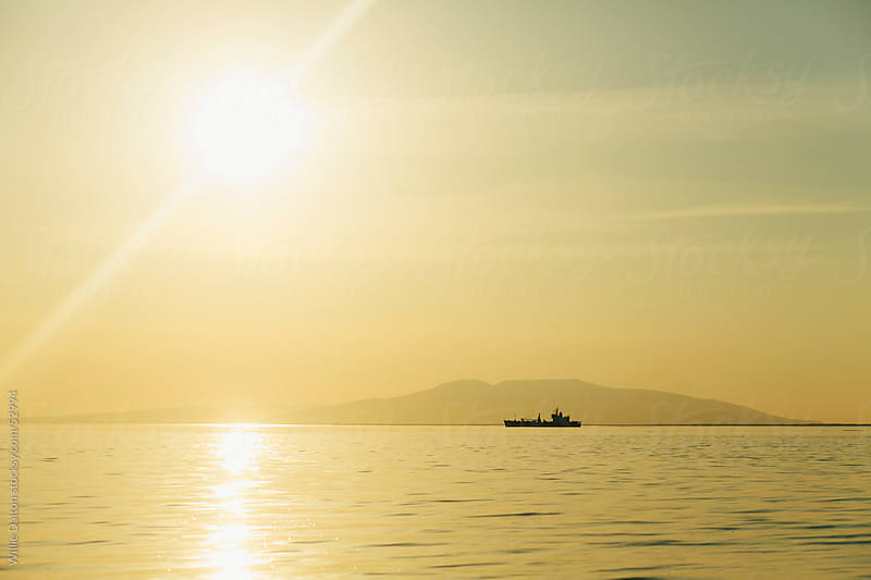 Sailing into the Sunset by Willie Dalton for Stocksy United