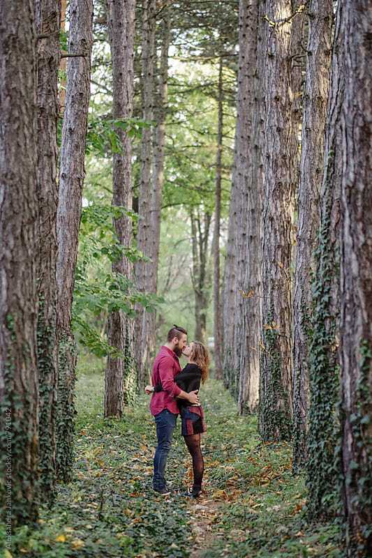 Embraced Young Couple in the Woods by Aleksandra Jankovic for Stocksy United