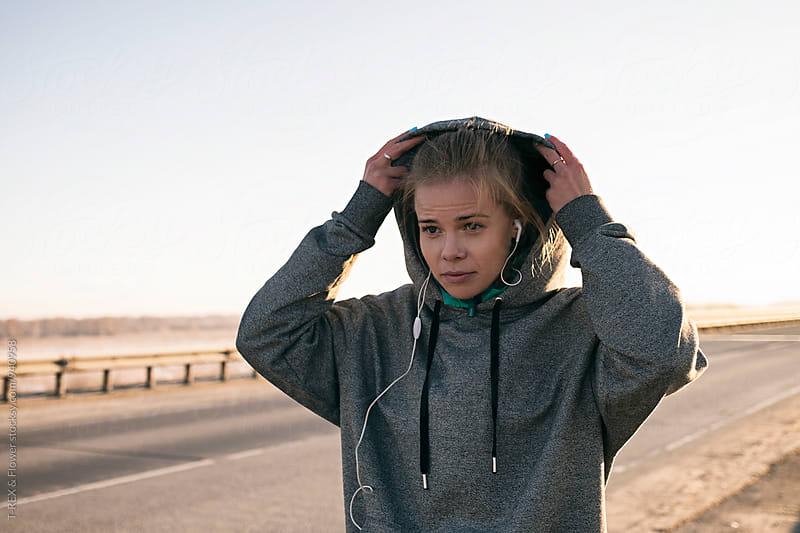 Sportswoman wearing hood by Danil Nevsky for Stocksy United
