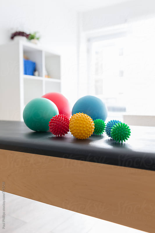 Group of spiky balls used in pilates for: exercises, therapy, massage and relaxation. Pilates studio by Paul Phillips for Stocksy United