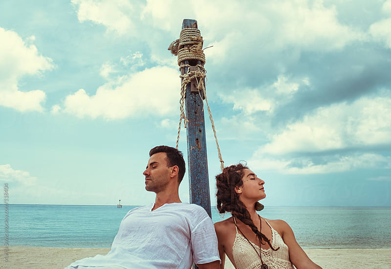 Couple enjoying the beach. by Marija Savic for Stocksy United