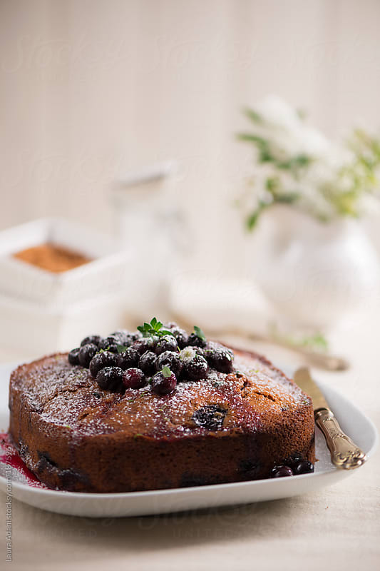 a squared blueberries cake with thyme  by Laura Adani for Stocksy United