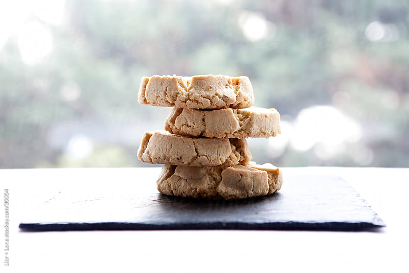 Stack of four peanut butter coockies by Lior + Lone for Stocksy United