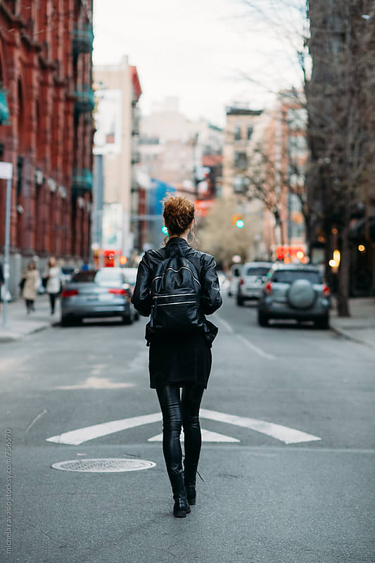 Young woman walking in the street by michela ravasio for Stocksy United