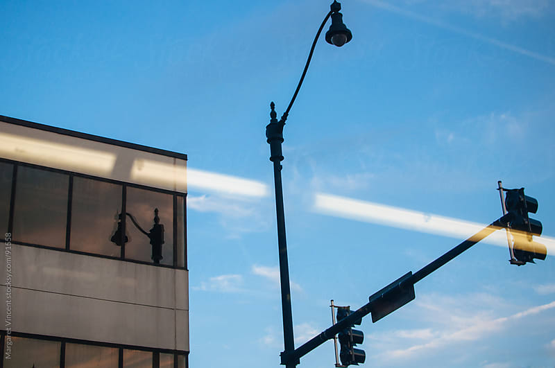 building, street light, and reflection by Margaret Vincent for Stocksy United