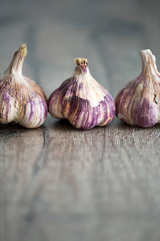 purple garlic by Lee Avison for Stocksy United