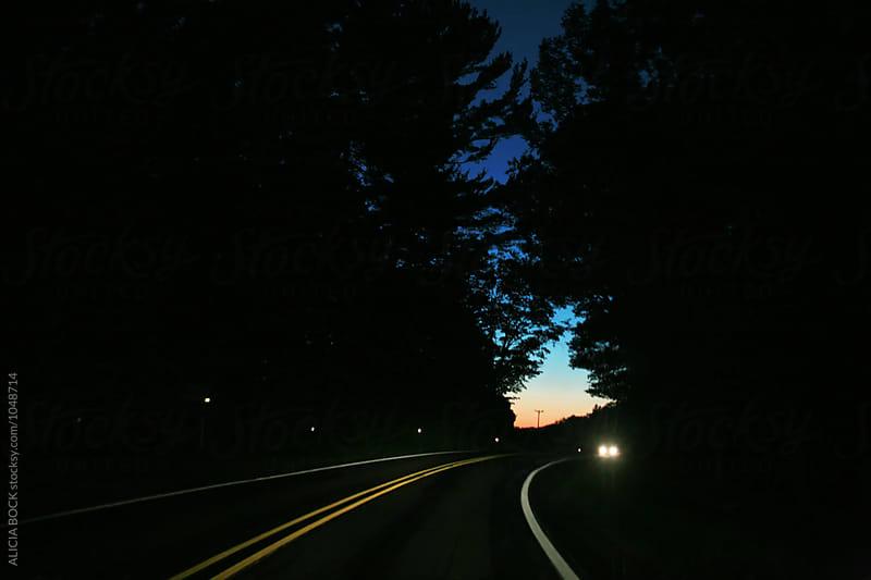 Auto Headlights Shining Around A Dark Curvy Road by ALICIA BOCK for Stocksy United