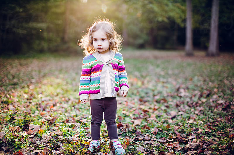 Toddler playing in a park during fall by Jakob for Stocksy United