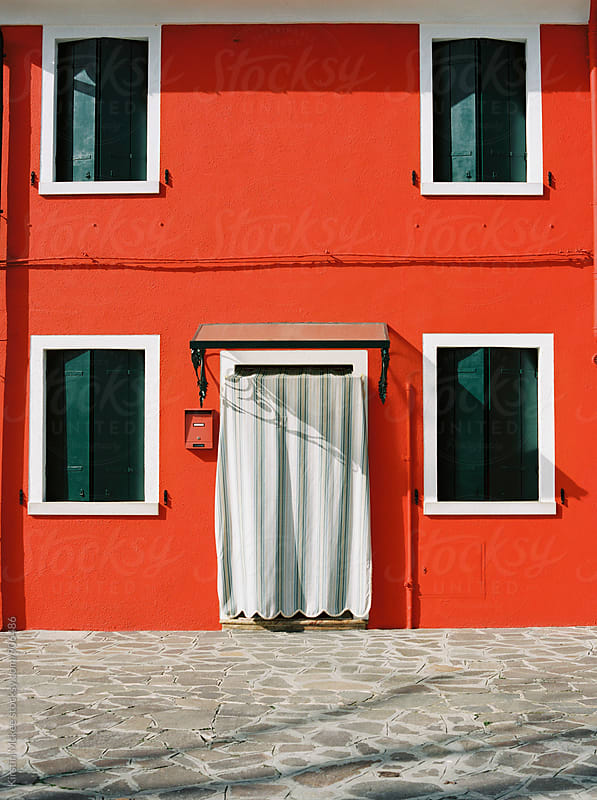 Exterior of a house in Burano by Kirstin Mckee for Stocksy United
