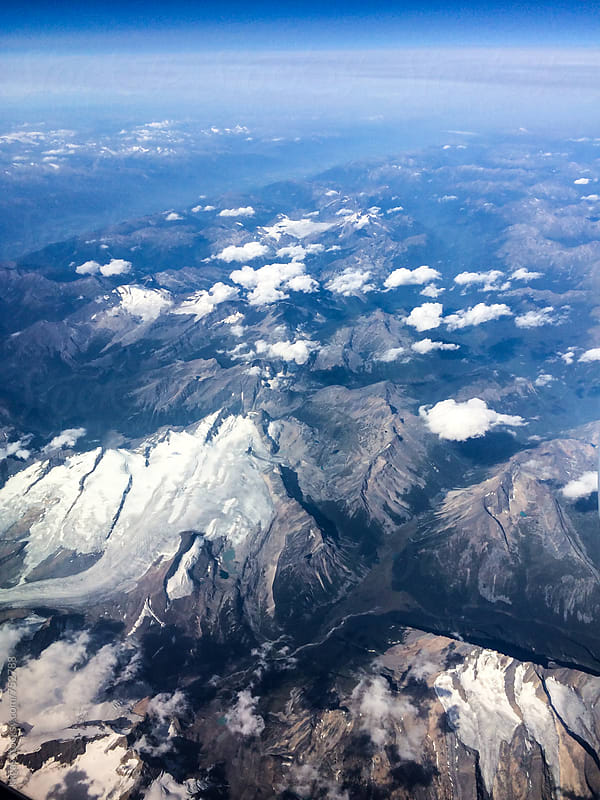 View of mountains and valleys over Canada as seen from the air. by kkgas for Stocksy United
