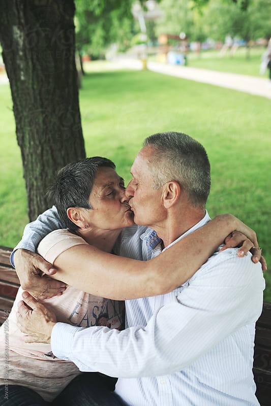 Elderly couple kissing by Jovana Rikalo for Stocksy United