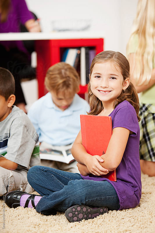 Classroom: Cute Girl During Reading Time by Sean Locke for Stocksy United