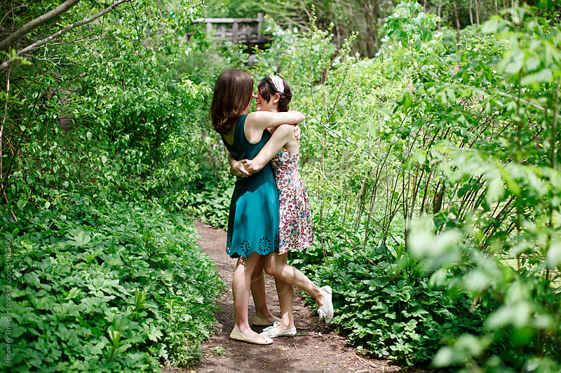 Two women in love hugging  by Jennifer Brister for Stocksy United
