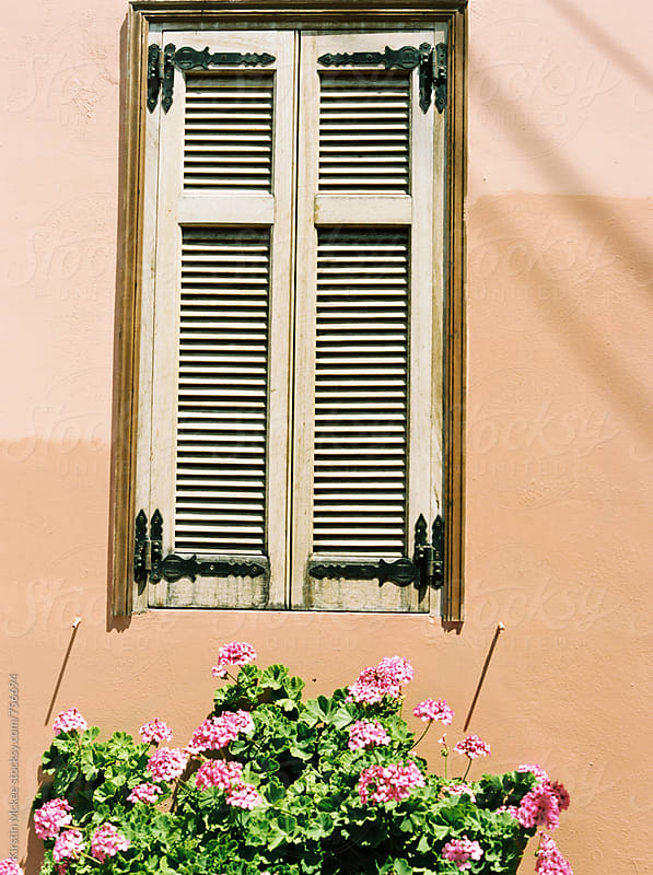 Window and flowers in Greece by Kirstin Mckee for Stocksy United