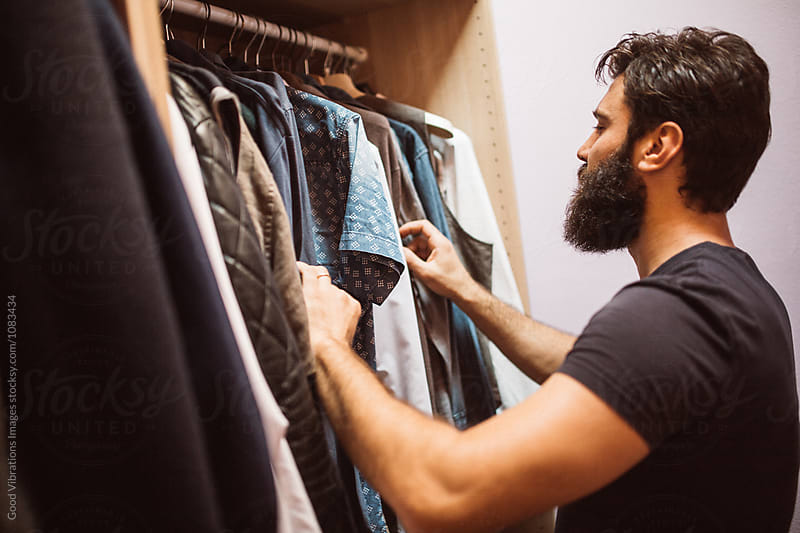 Man searching for the right shirt by Good Vibrations Images for Stocksy United