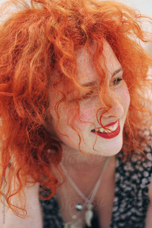 Portrait of a ginger haired woman smiling by Jovana Rikalo for Stocksy United