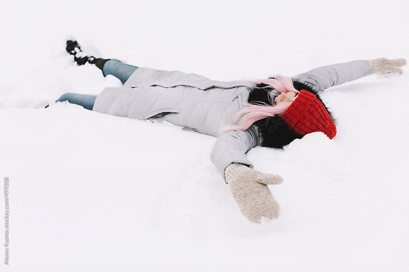 happy girl on the snow by Alexey Kuzma for Stocksy United
