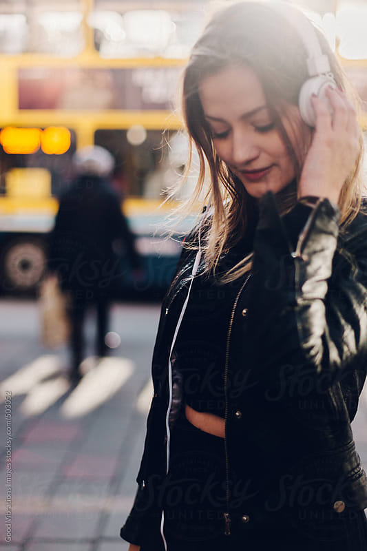 Beautiful woman listening music by Good Vibrations Images for Stocksy United